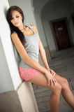 Slender young brunette woman posing. Royalty Free Stock Images