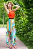 Slender young girl posing in the  park Stock Photos
