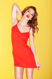 Slender young girl in red dress Stock Photography