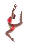 Slender young gymnast posing in jump Royalty Free Stock Image