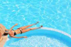 A slender young woman in a bikini Stock Photography