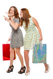Slender young woman while shopping with bags Royalty Free Stock Photography