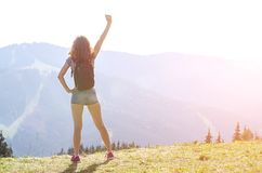 Slender young woman on top of a mountain, copy space. Tourism, active rest Royalty Free Stock Image