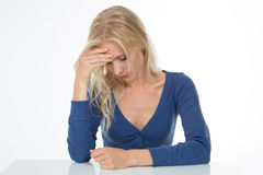 Slepping woman on  background. Beautiful girl exhausted and worried sustain her head Stock Image