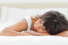 Slepping woman on her bed Stock Image