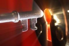Sleutel & sleutelgat met licht Royalty-vrije Stock Afbeelding