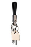 sleutel in bijlage aan een leer keychain Stock Foto's
