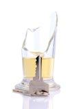 Sleutel door een gebroken glas Royalty-vrije Stock Foto