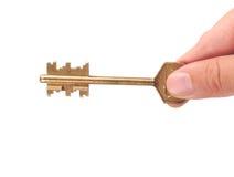 Sleutel in een hand van het slot Stock Afbeeldingen
