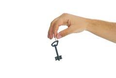 Sleutel in een hand van mensen Stock Afbeelding
