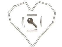 Sleutel in het hart. Stock Foto