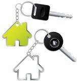 Sleutels met huis gevormde keyholders vector illustratie