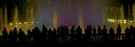Slhouette de la gente imagenes de archivo