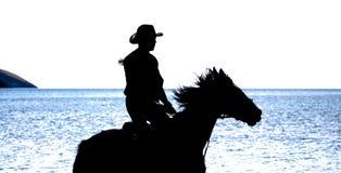 Slhouette del vaquero en caballo Fotos de archivo libres de regalías