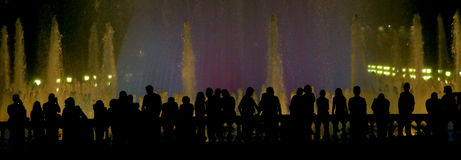 Slhouette of the people. Silhouette of the peoples standing at Fuenta Magica in Barcelona stock images