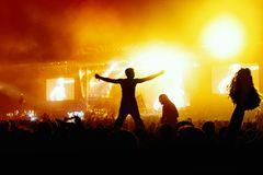 Slhouette of young man on concert. Big festival event Stock Photography