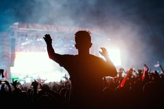 Slhouette of young man on concert Royalty Free Stock Image