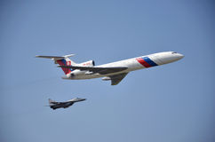 Sliac, Slovakia - August 27, 2011: Flight display of jet airliner Tupolev Tu-154M escorted by jet air figh Stock Photos