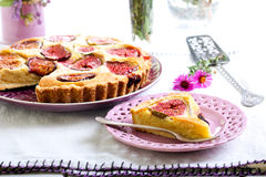 Slice of almond and fig tart Stock Images