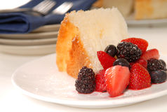 Slice of Angel Food Cake with fresh fruit Stock Images