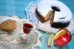 SLICE OF AND APPLE CAKE WITH HOMEMADE LIQUOR FOR A TREAT 2 Stock Photography