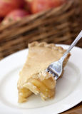 Slice of Apple Pie. A bite of apple pie on a fork Stock Photos