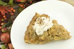 A Slice of Apple Pie with Fall Decorations Stock Images