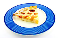 Slice of Apple and Strawberry Pie. On a blue plate on a white background Royalty Free Stock Photos