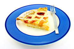 Slice of Apple and Strawberry Pie with a Fork. Slice of apple and strawberry pie on a blue plate with a small fork on a white background Stock Images