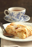 Slice of apple strudel and cup of tea Royalty Free Stock Images
