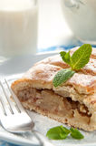 Slice of apple strudel with ta glass of milk Stock Image