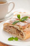 Slice of apple strudel with tea Stock Photography
