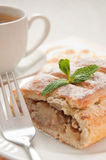 Slice of apple strudel with tea Royalty Free Stock Photo