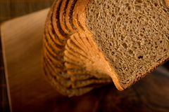 Slice arrangement. Sliced bread vertical arrangement on a cutting board royalty free stock image
