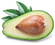 Slice of avocado with leaves. Royalty Free Stock Photos