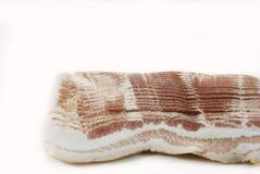 Slice of bacon. Slices of smoked pork bacon on white background Stock Photos