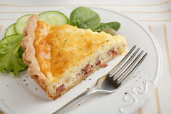 Slice of Bacon and Egg Pie Stock Photo