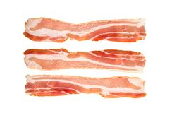 A slice of bacon on a white background. stock photos