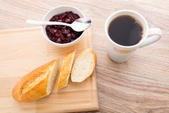 Slice of baguette with cherry jam Royalty Free Stock Photos