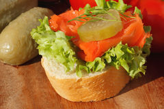 Slice of baguette with pollock fillet Royalty Free Stock Photography