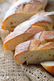 Slice Baguette on the sackcloth Royalty Free Stock Photos