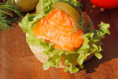 Slice of baguette with smoked salmon filet Stock Photography