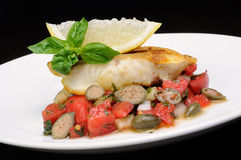 Slice of baked fish perch with vegetables royalty free stock photo