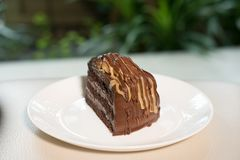 Banana caramel chocolate cake. tasty delicious dessert on white Stock Photo