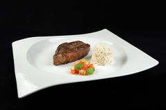 Slice of barbecued cow beef picanha with rice, tomato salad an Stock Photography