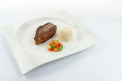 Slice of barbecued cow beef picanha with rice, tomato salad an Royalty Free Stock Photography