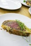 Beef Wellington on plates Royalty Free Stock Image