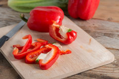 Slice bell pepper on wood cutting board. Royalty Free Stock Images