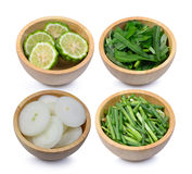 Slice bergamot fruit,water spinach,Slice onion,Slice green onions in wooden bowl isolated on a white. Background stock image