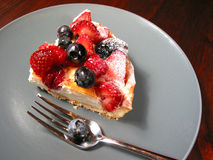Slice of berry cake on a plate stock image